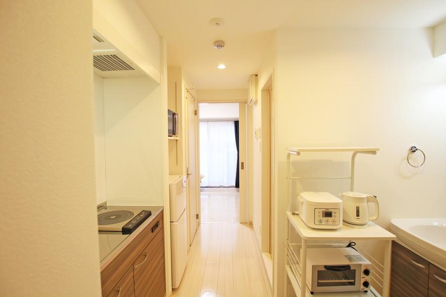 廊下は室内と同じく温かみのあるフローリングを採用