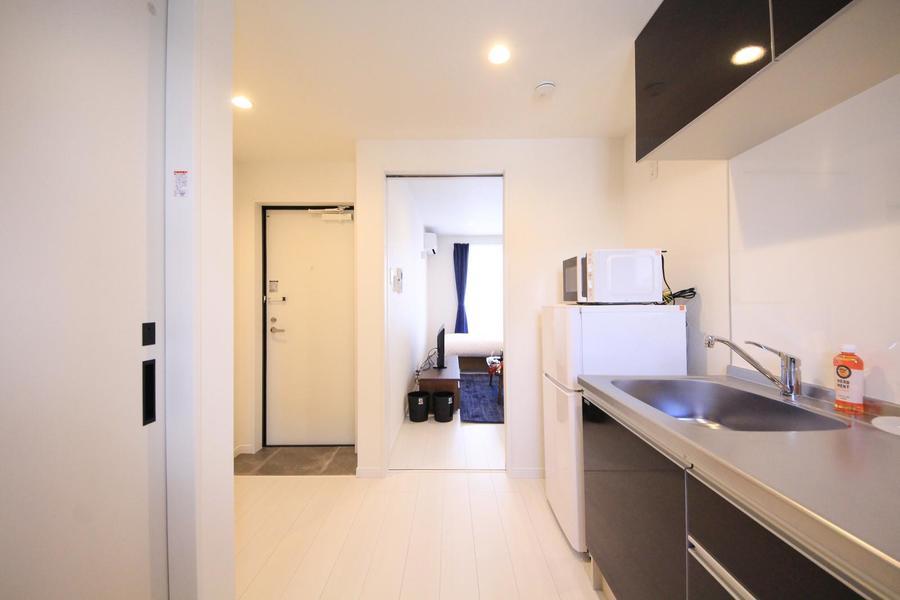廊下もお部屋と同じフローリング。色合いを合わせることで統一感アップ