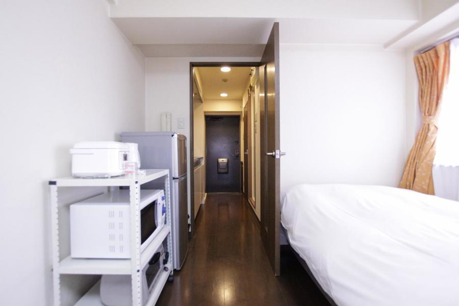 玄関もお部屋と同じくダークブラウンのフローリングで統一感があります