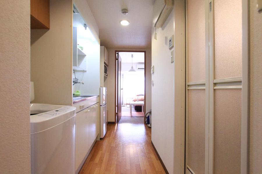 廊下やキッチンは木目調があたたかなフローリング